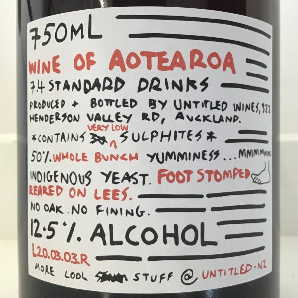 Pinot cubed - Red Edition - back label close up. Wine of Aotearoa. Very low sulphur. Approx 50% whole bunch. Foot stomped. Reared on lees. No oak. No fining. 750mL. Approx 7.4 standard drinks. 12.5% alcohol