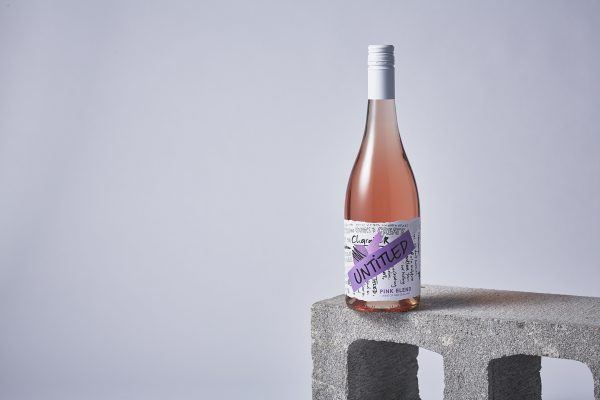 On a concrete block, there's a bottle of Untitled Wine's Pink Blend looking very sophisticated and arty. This is wine is a pink wine also know as rosé